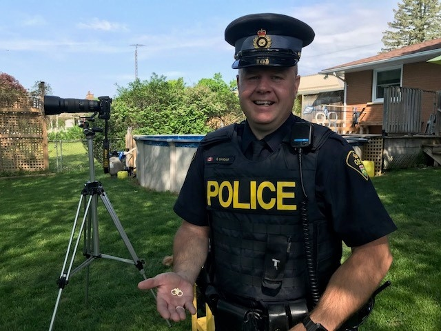 OPP Const. Ed Sanchuk is ready for the capture of some squirrely suspects in Simcoe, Ont. on Monday, May 25, 2020. (Sean Irvine / CTV London)