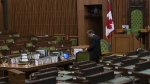 A House of Commons clerk prepares for the COVID-19 committee to meet in the House of Commons Chamber Wednesday April 29, 2020 in Ottawa. THE CANADIAN PRESS/Adrian Wyld
