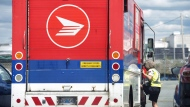 A Canada Post employee climbs into a mail truck in Halifax on Wednesday, July 6, 2016.Canada Post swung to a $66-million loss before taxes in the first quarter despite a surge in parcel volumes near the start of the COVID-19 lockdown. THE CANADIAN PRESS/Darren Calabrese