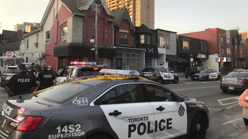 Police are pictured at Harbord and Robert streets downtown following a police chase involving a stolen cruiser Saturday May 23, 2020. (Kelly Linehan /CP24)