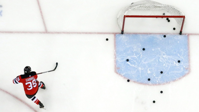 FILE - In this Feb. 17, 2019, file photo, New Jersey Devils right wing Kurtis Gabriel works out prior to an NHL hockey game against the Buffalo Sabres in Newark, N.J. (AP Photo/Julio Cortez, File)