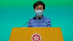 Hong Kong Chief Executive Carrie Lam listens to reporters' questions during a press conference in Hong Kong, Tuesday, May 26, 2020. (AP Photo/Vincent Yu)
