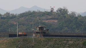 In this May 3, 2020, file photo, military guard posts of North Korea, rear, and South Korea, bottom, are seen in Paju, at the border with North Korea, South Korea. (AP Photo/Ahn Young-joon, File)