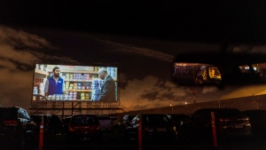People enjoy a movie at the parking lot of the Carrasco International Airport after it was converted into a drive-in cinema, on the outskirts of Montevideo, Uruguay, Monday, May 25, 2020. (AP Photo/Matilde Campodonico)