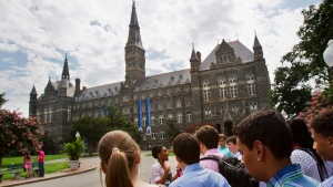 Prospective students tour Georgetown University's campus in Washington, in this Wednesday, July 10, 2013, file photo. (AP Photo/Jacquelyn Martin, File)