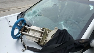 Police in North Bay are hoping someone can help identify the person who smashed this windshield -- and the source of the shutoff valve they used to do it. (Photo courtesy of North Bay Police)