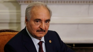 In this Jan. 17, 2020, file, photo, Libyan Gen. Khalifa Hifter joins a meeting with the Greek Foreign Minister Nikos Dendias in Athens. The U.S. military Tuesday, May 26, 2020 accused Russia of deploying fighter planes to conflict-stricken Libya to support Russian mercenaries aiding east-based forces in their offensive on the capital, Tripoli. (AP Photo/Thanassis Stavrakis, File)