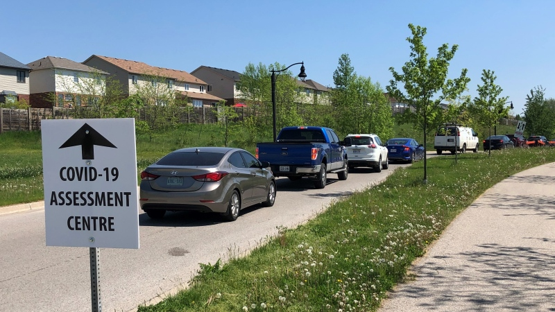 Vehicles line up at the COVID-19 assessment centre at the Carling Heights Optimist Community Centre in London, Ont. on Tuesday, May 26, 2020. (Jim Knight / CTV London)