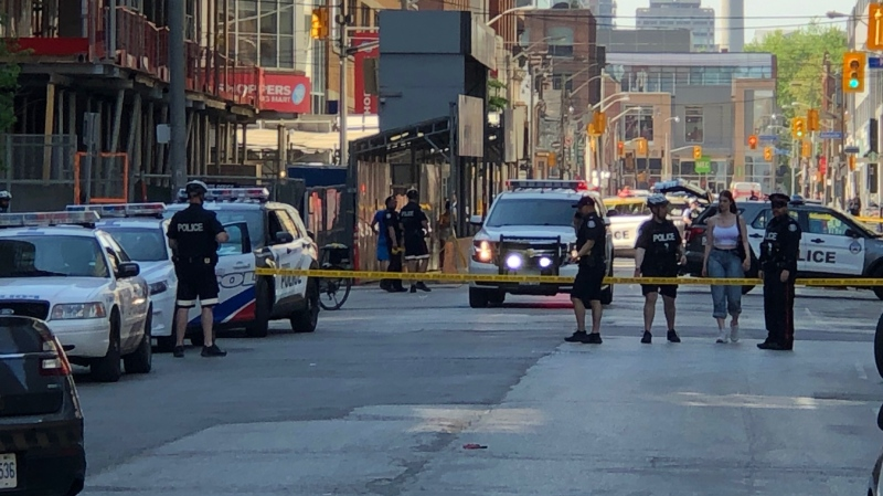 Toronto police are pictured at the scene of a shooting at King and Blue Jays Way Tuesday May 26, 2020. (Christopher Broadly)