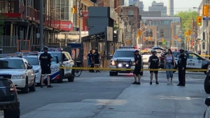 Several people are injured following a daylight shooting in Toronto's Entertainment District Tuesday afternoon. (CTV News Toronto/Christopher Broadly)