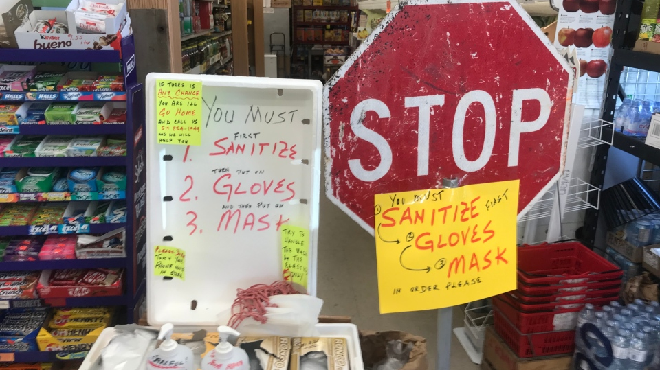 Customers at west-end grocer Giglio's Market are greeted with a new policy requiring them to use hand sanitizer, wear gloves and a face mask on May 26, 2020. (Rich Garton / CTV Windsor)