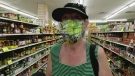 Ccustomer Jude Quick wears a cloth mask to shop at Giglio's Market in west Windsor, Ont., on May 26, 2020. (Rich Garton / CTV Windsor)