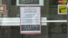 Savvy Footwear and Accessories in Brockville has a sign on the door to remind customers of the COVID-19 measures. (Nathan Vandermeer/CTV News Ottawa)