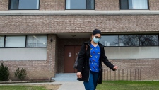 A healthcare worker leaves after finishing her shift for the day at the Eatonville Care Centre in Toronto on Friday, April 24, 2020. The facility as been one of the hardest hit care centres with the COVID-19 pandemic in the country. THE CANADIAN PRESS/Nathan Denette
