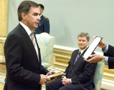 Jim Prentice is sworn as the new Minister of Industry as Prime Minister Stephen Harper looks on during a ceremony at Rideau Hall, August 14, 2007 in Ottawa. (CP / Fred Chartrand)