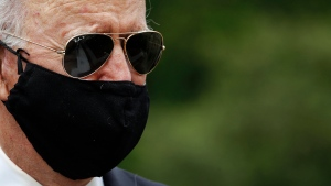 U.S. Democratic presidential candidate, former Vice President Joe Biden wears a face mask to protect against the spread of the new coronavirus as he and Jill Biden depart after placing a wreath at the Delaware Memorial Bridge Veterans Memorial Park, Monday, May 25, 2020, in New Castle, Del. (AP Photo/Patrick Semansky)
