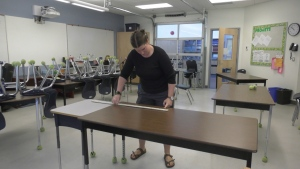 A teacher setting up a physically distanced classroom in B.C. in May, 2020.
