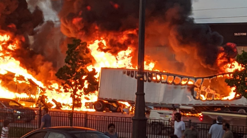 Two tractor trailers burn following a collision at Highway 50 and Castle Oaks Crossing in Brampton Tuesday May 26, 2020. (@drkpchavda71 /Twitter)