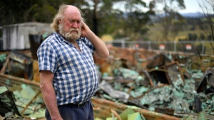 Wayne Keft, whose home was destroyed by the fires, says recovery has been 'slow and difficult' for many. (AFP)