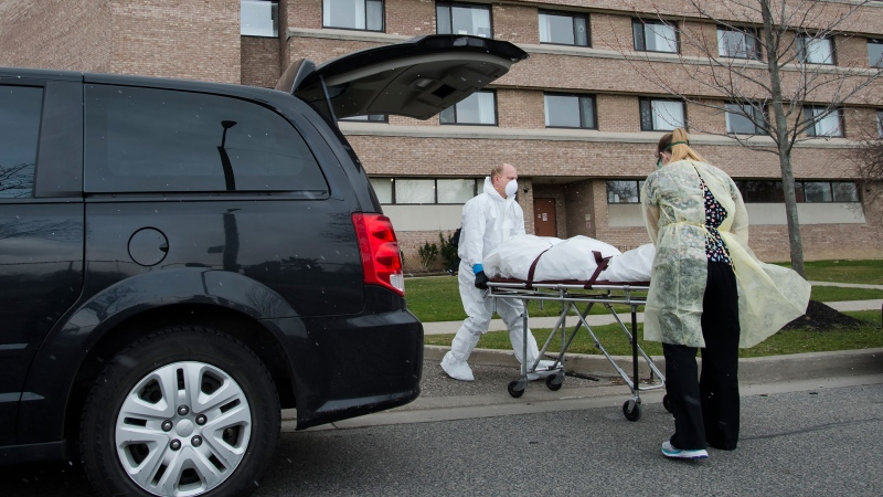A body is wheeled from the Eatonville Care Centre, where multiple deaths from COVID-19 have occurred, in Toronto on Tuesday, April 14, 2020. THE CANADIAN PRESS/Nathan Denette