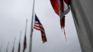 In this May 22, 2020, file photo, a raindrop falls from an American flag at half-staff at the Washington Monument, in Washington. (AP Photo/Patrick Semansky, File)