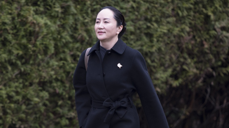 Meng Wanzhou, chief financial officer of Huawei, leaves her home to go to B.C. Supreme Court in Vancouver, Wednesday, January 22, 2020. (THE CANADIAN PRESS/Jonathan Hayward)