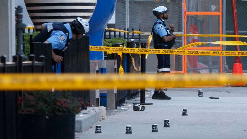 Toronto Police work the scene of a shooting in downtown Toronto, Tuesday, May 26, 2020. THE CANADIAN PRESS/Cole Burston