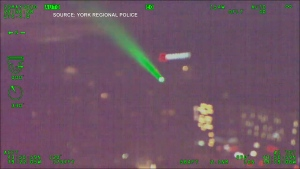 A green laser is pointed at a police helicopter flying in York Region. (York Regional Police)