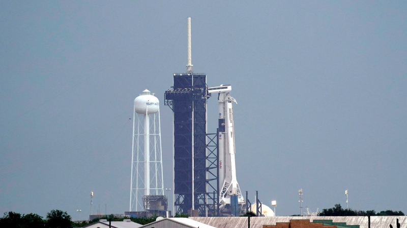 The SpaceX Falcon 9, with the Crew Dragon spacecraft on top of the rocket, sits on Launch Pad 39-A Wednesday, May 27, 2020, at Kennedy Space Center in Cape Canaveral, Fla. Two astronauts will fly on the SpaceX Demo-2 mission to the International Space Station scheduled for launch Wednesday afternoon. (AP Photo/David J. Phillip)