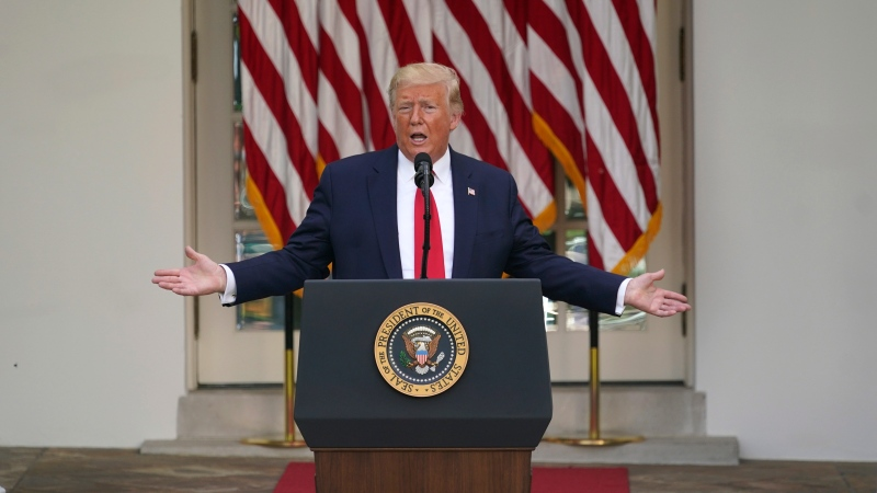 U.S. President Donald Trump answers questions from reporters during an event on protecting seniors with diabetes in the Rose Garden White House, Tuesday, May 26, 2020, in Washington. (AP Photo/Evan Vucci)