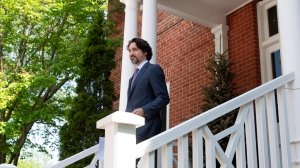 Prime Minister Justin Trudeau steps out of Rideau Cottage for a news conference in Ottawa, Wednesday May 27, 2020. THE CANADIAN PRESS/Adrian Wyld