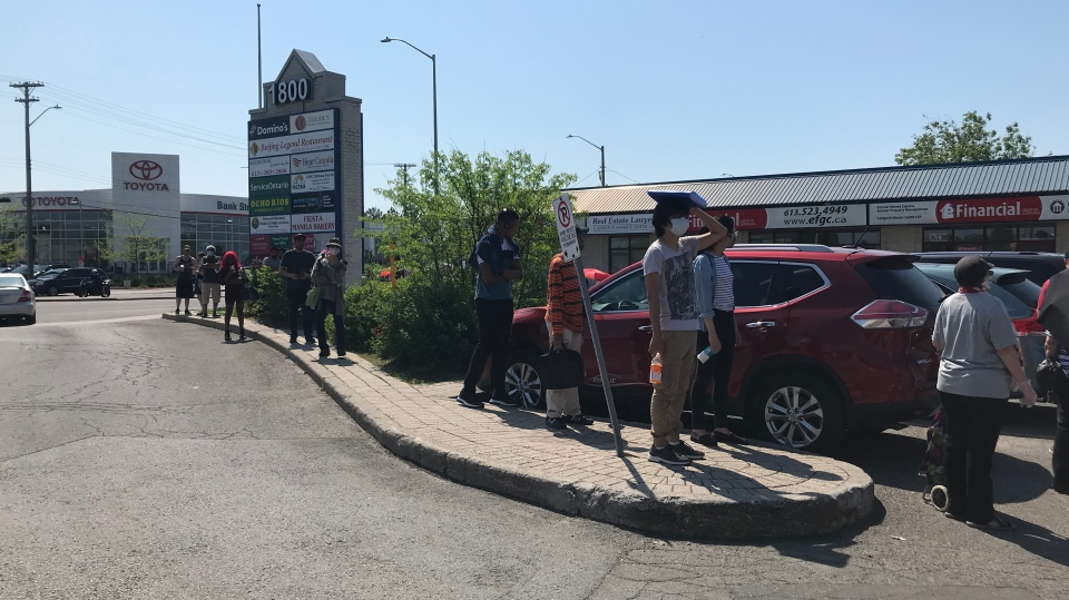 Service Ontario has cut hours during the COVID-19 pandemic, creating long lines to access services. (Leah Larocque/CTV News Ottawa)