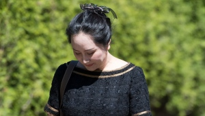 Meng Wanzhou, chief financial officer of Huawei, leaves her home to go to B.C. Supreme Court in Vancouver, Wednesday, May 27, 2020. (THE CANADIAN PRESS/Jonathan Hayward)