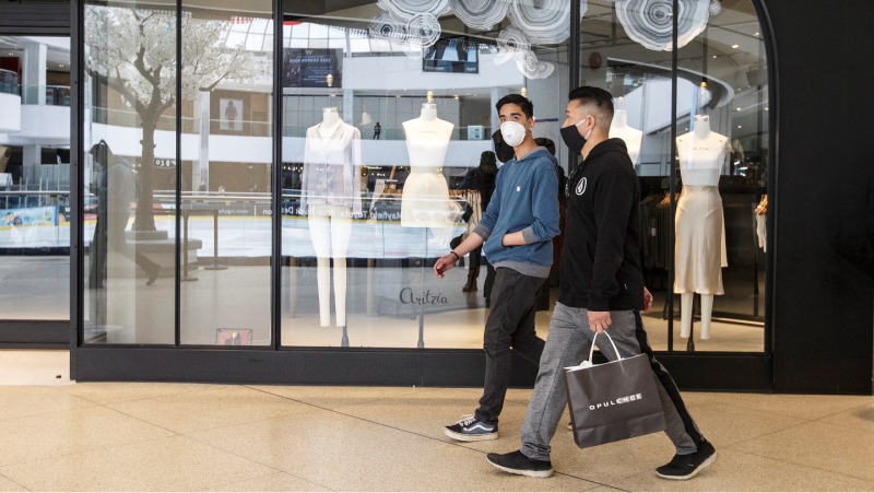 Shoppers walk past stores in the West Edmonton Mall on the first day of the mall's reopening during the COVID-19 pandemic, in Edmonton on Thursday, May 14, 2020. THE CANADIAN PRESS/Jason Franson