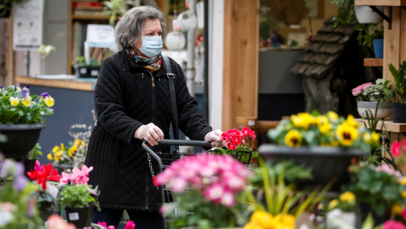 Customers shop at the Golden Acre Home and Garden centre facility in Calgary, Alta., Tuesday, April 14, 2020, amid a worldwide COVID-19 pandemic. THE CANADIAN PRESS/Jeff McIntosh