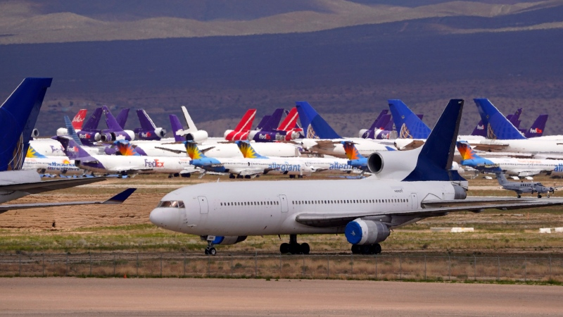 In this March 25, 2020, file photo, passenger and cargo aircraft are seen stored at Southern California Logistics Airport, in Victorville, Calif. (AP Photo/Mark J. Terrill, File)
