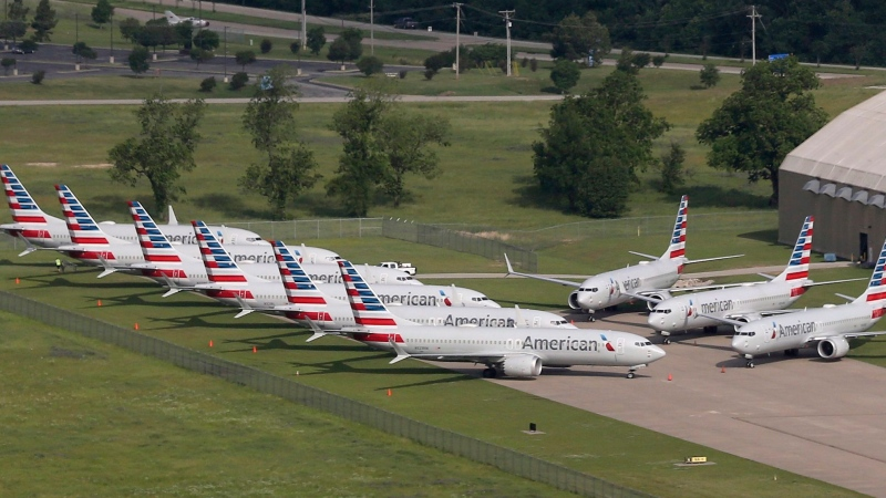 In this May 24, 2019, file photo, grounded Boeing 737 Max jets belonging to American Airlines are stored at Tulsa International Airport in Tulsa, Okla. American Airlines said Thursday, Jan. 2, 2020, it is negotiating with Boeing over compensation for the airline's grounded planes and will share some of the proceeds with its employees. (Tom Gilbert/Tulsa World via AP, File)