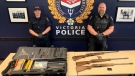 Police say that three guns and dozens of weapons (pictured above) were seized Tuesday morning: (VicPD)
