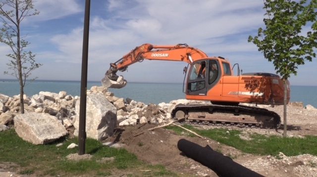 Heavy machinery works along the shoreline of Lake Huron in Goderich, Ont. on Wednesday, May 27, 2020. (Scott Miller / CTV London)