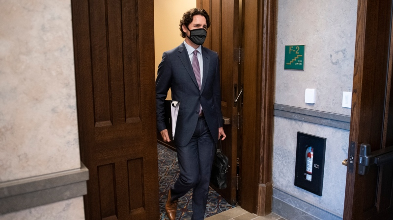 Prime Minister Justin Trudeau arrives in the foyer of the House of Commons on Parliament Hill for a meeting of the Special Committee on the COVID-19 Pandemic in Ottawa, on Wednesday, May 27, 2020. THE CANADIAN PRESS/Justin Tang