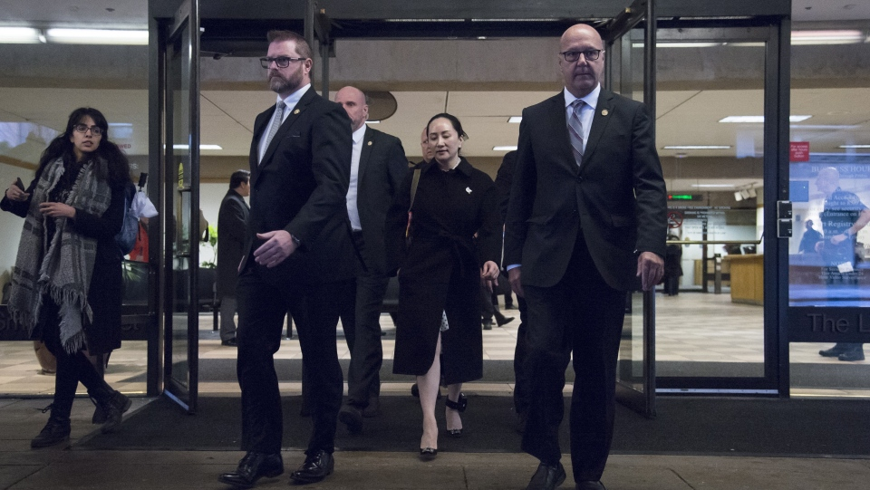 Meng Wanzhou, chief financial officer of Huawei, leaves B.C. Supreme Court in Vancouver on January 23, 2020. A former ambassador to China says tomorrow's decision in the extradition case of Huawei exective Meng Wanzhou could also determine the fate of two Canadians detained in China. David Mulroney, who served as Canada's ambassador to the People's Republic of China between 2009 to 2012, says if Meng is released then he expects China will eventually follow suit and release Michael Kovrig and Michael Spavor. THE CANADIAN PRESS/Jonathan Hayward