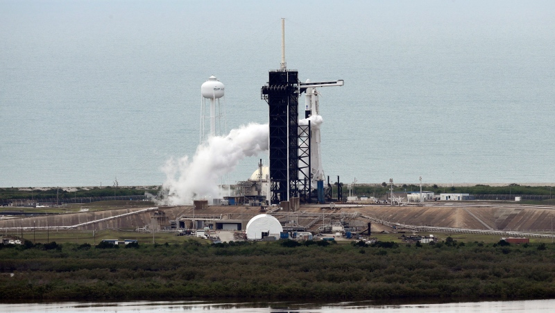 A SpaceX Falcon 9 at the Kennedy Space Center in Cape Canaveral, Fla., Wednesday, May 27, 2020. The vehicle is venting as the mission was scrubbed. (AP Photo/Chris O'Meara)