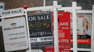 Real estate for sale signs are shown in Oakville, Ont. on Saturday, Dec.1, 2018. (THE CANADIAN PRESS / Richard Buchan)