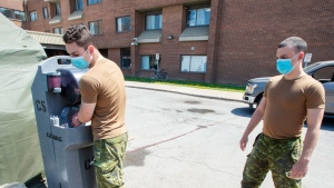 Canadian Forces personnel wash up before their break at the Vigi Mount Royal CHSLD seniors residence Tuesday May 26, 2020 in Montreal. THE CANADIAN PRESS/Ryan Remiorz