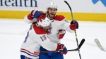 Montreal Canadiens defenceman Ben Chiarot (8) celebrates his game-winning goal with centre Max Domi (13) in overtime of an NHL hockey game against the Washington Capitals, Thursday, Feb. 20, 2020, in Washington. While the prospect of North America's sports leagues returning to action in a sequestered location is appealing to those looking for a return to normalcy, NHL players Tyler Myers and Chiarot say athletes would need to consider the possibility of being separated form their families for a long period of time.THE CANADIAN PRESS/AP/Nick Wass