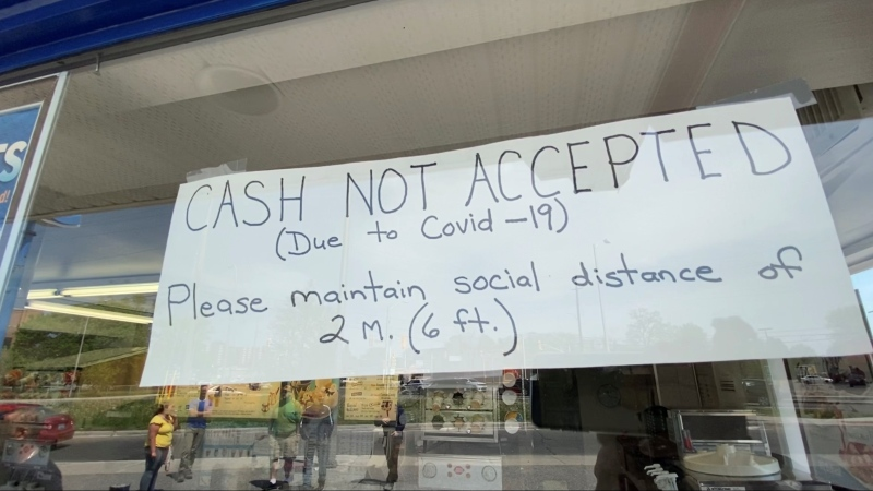 A sign posted on the window of Dairy Queen on Merivale Road instructing cashless transactions only. Ottawa, ON. May 26, 2020. (Tyler Fleming / CTV News Ottawa)