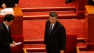 Chinese President Xi Jinping, center, prepares to leave after the closing session of the Chinese People's Political Consultative Conference (CPPCC) at the Great Hall of the People in Beijing on Wednesday, May 27, 2020. (AP / Andy Wong)