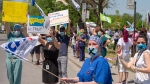 Healthcare workers demanding time off for COVID-19 fatigue protest in front of Maisonneuve Rosemont hospital Wednesday May 27, 2020 in Montreal. THE CANADIAN PRESS/Ryan Remiorz