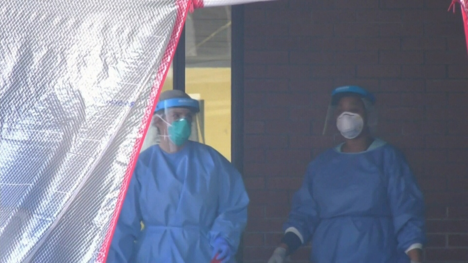 Health workers in protective PPE COVID gear