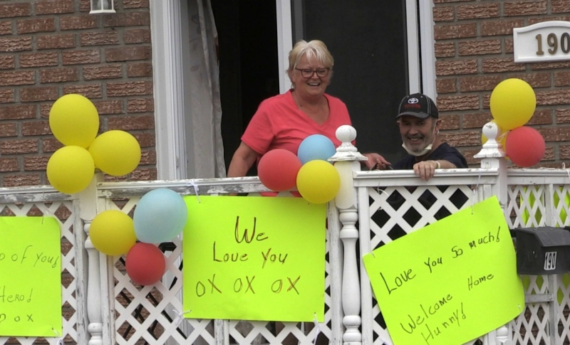 Carole and Graham Bushey wave during a welcome home parade Wednesday in Timmins. Graham,. who preferred not to speak with the media as he recovers, beat COVID-19 after a difficult battle. (Sergio Arangio/CTV News)